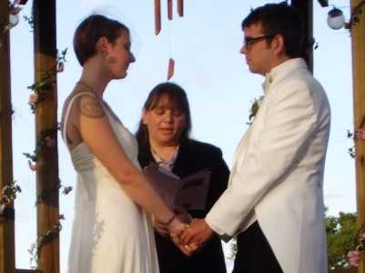 Wedding scene - bride, groom and Kya as the officiant